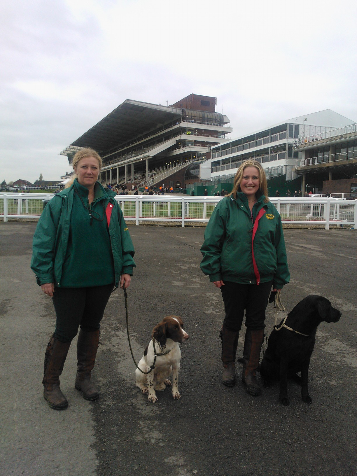 Chris (left) and Cathy (right) together in the UK with their canine friends Paddy (left) and Inca (right)!