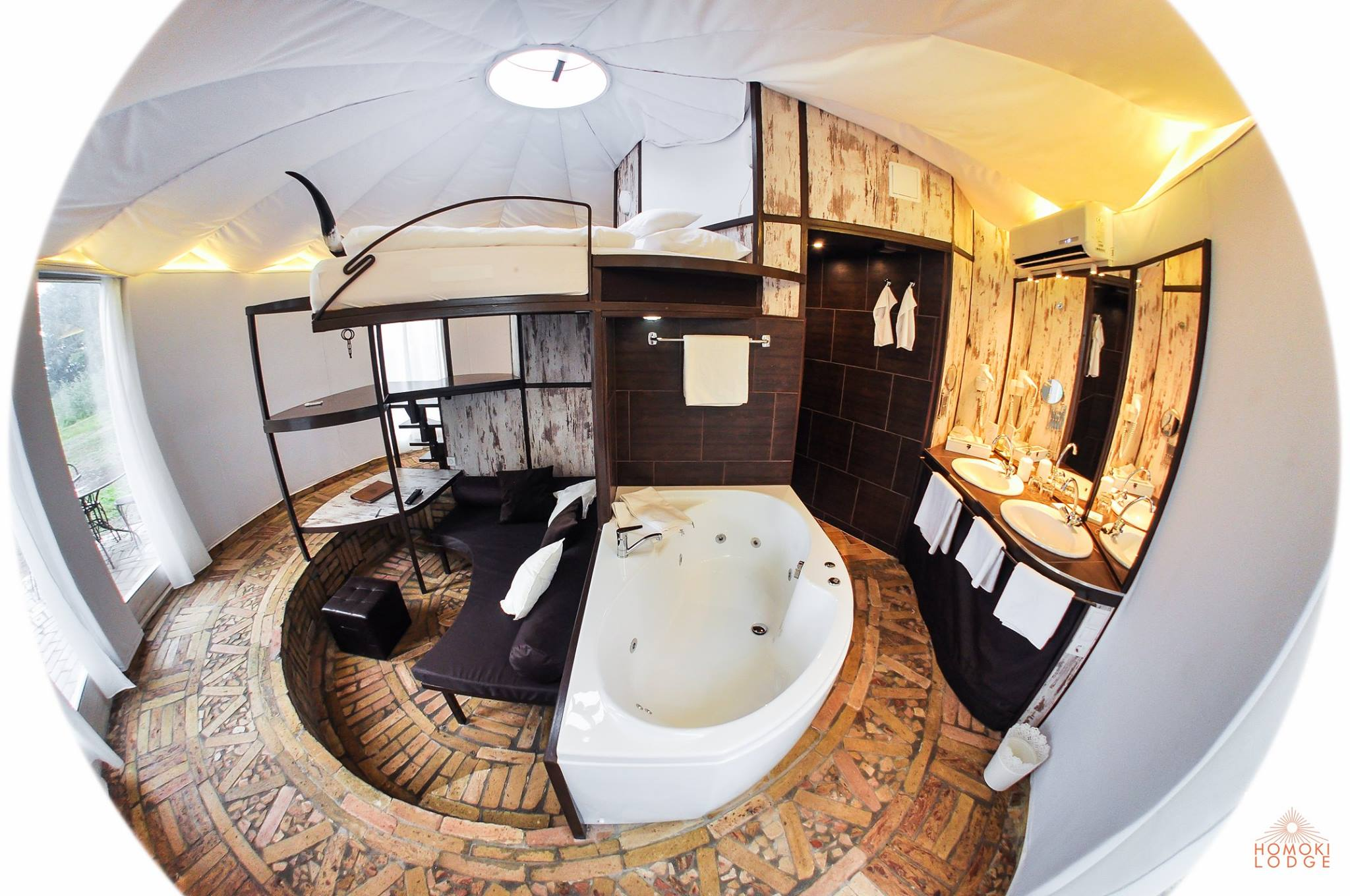 Jacussi bath and separate shower in the Luxury Yurt