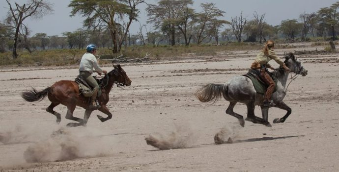 Jo and Bob racing, Kaskazi Horse Safaris