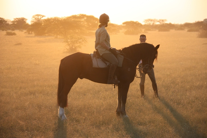 David taking advantage of the African evening sunset, to get some piccies of my lovely ride for the week, General.